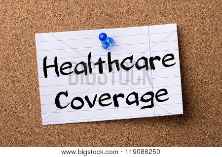 Healthcare Coverage - Teared Note Paper Pinned On Bulletin Board