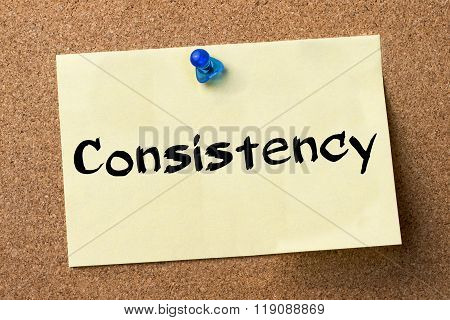 Consistency - Adhesive Label Pinned On Bulletin Board