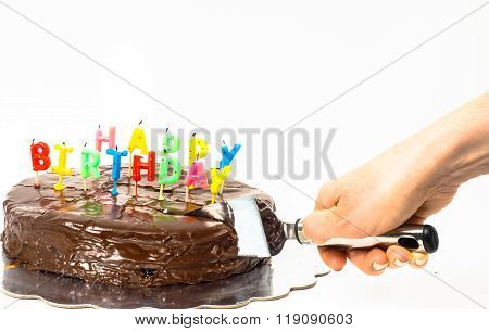 Female Person Cutting A Homemade Sacher Chocolate Cake With Birthday Candles