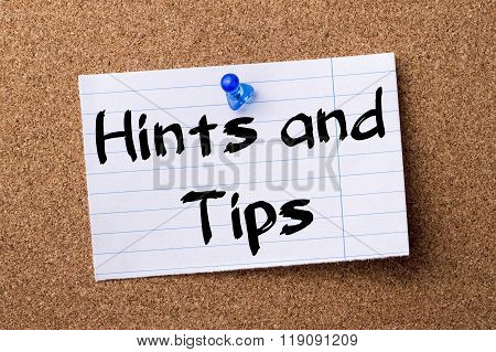 Hints And Tips - Teared Note Paper Pinned On Bulletin Board