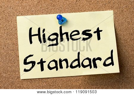 Highest Standard - Adhesive Label Pinned On Bulletin Board