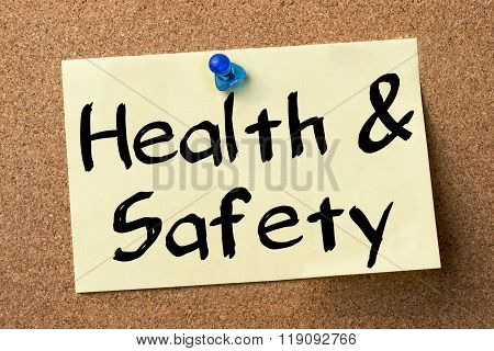 Health & Safety - Adhesive Label Pinned On Bulletin Board
