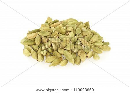 Scattered unrefined ?ardamom seeds on white background