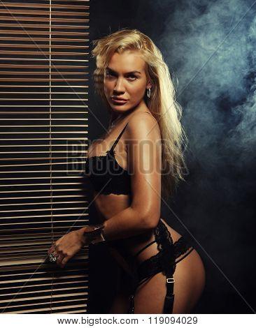 young sexy striptease dancer