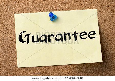 Guarantee - Adhesive Label Pinned On Bulletin Board