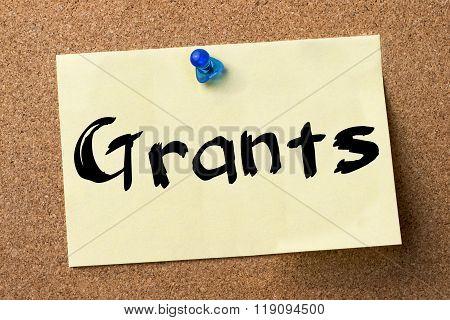 Grants - Adhesive Label Pinned On Bulletin Board