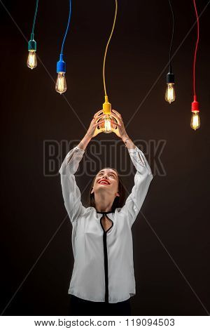 Woman with illuminated retro lamps