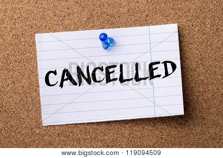 Cancelled - Teared Note Paper Pinned On Bulletin Board