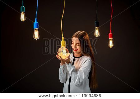 Young woman surrounded by colored lights