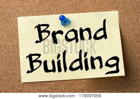 Brand Building - Adhesive Label Pinned On Bulletin Board