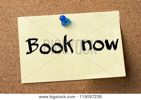 Book Now - Adhesive Label Pinned On Bulletin Board