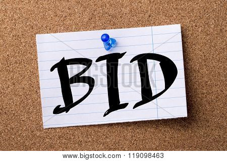 Bid - Teared Note Paper Pinned On Bulletin Board