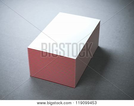 Stack of white business cards with red edges