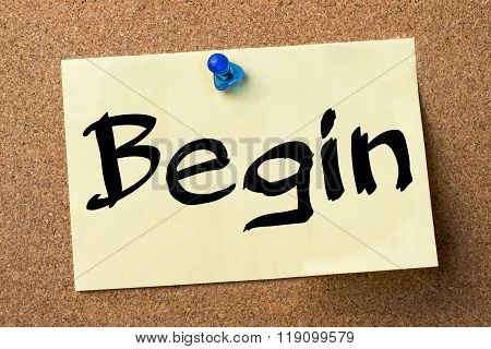 Begin - Adhesive Label Pinned On Bulletin Board