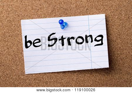 Be Strong - Teared Note Paper Pinned On Bulletin Board