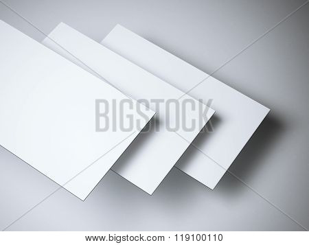 Three empty white business cards