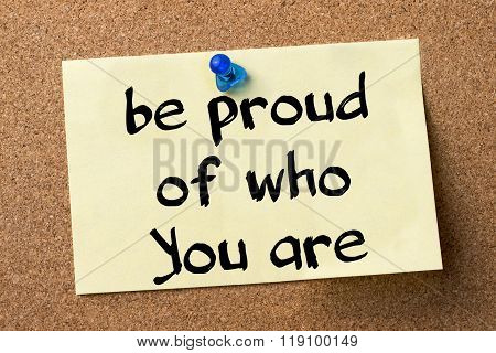 Be Proud Of Who You Are - Adhesive Label Pinned On Bulletin Board