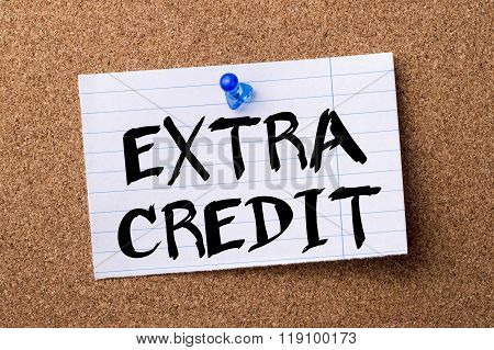 Extra Credit - Teared Note Paper Pinned On Bulletin Board