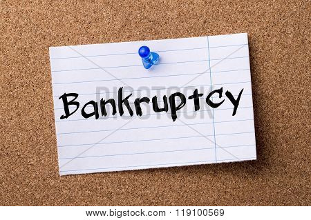 Bankruptcy - Teared Note Paper Pinned On Bulletin Board