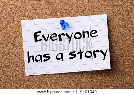Everyone Has A Story - Teared Note Paper Pinned On Bulletin Board