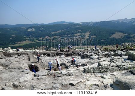 Group of workers doing excavations on the hill of Perperikon