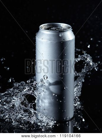 beer can with water splashes