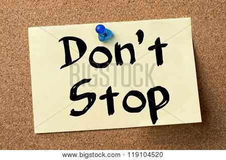 Don't Stop - Adhesive Label Pinned On Bulletin Board