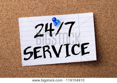 24/7 Service - Teared Note Paper Pinned On Bulletin Board