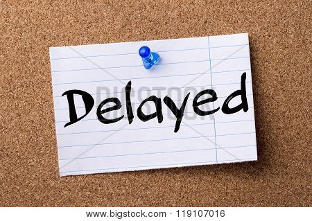 Delayed - Teared Note Paper Pinned On Bulletin Board