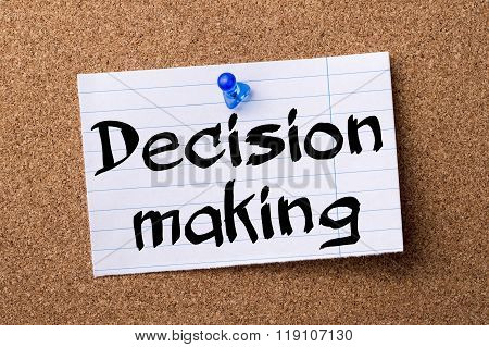 Decision Making - Teared Note Paper Pinned On Bulletin Board