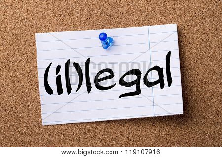 (il)legal - Teared Note Paper Pinned On Bulletin Board