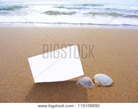 blank postcard in the sand