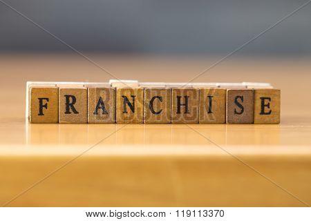 Franchise. Word Written On Wood Block