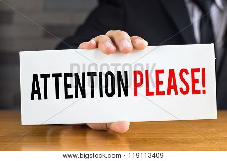 Attention Please, Message On White Card And Hold By Businessman
