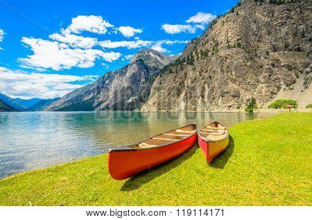 Majestic mountain lake in Canada. Seton Lake in British Columbia, Canada. Red canoe.