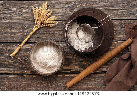 Flour In A Wooden Bowl On Dark Wooden Background