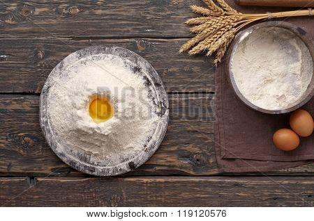 Handful Of Flour With Egg Yolk