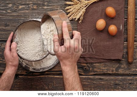 Baker Sift The Flour To Make Bread