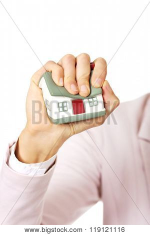 Aggresive business woman crushing small house