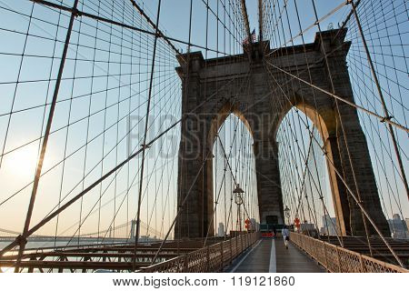 Historic and Iconic Brooklyn Bridge Arches with View of Manhattan Bridge Spanning East River in Background at Sunset, New York City, New York, USA