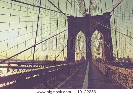 Retro Washed Out Color View of Historic and Iconic Brooklyn Bridge Arches with View of Manhattan Bridge Spanning East River in Background at Sunset, New York City, New York, USA