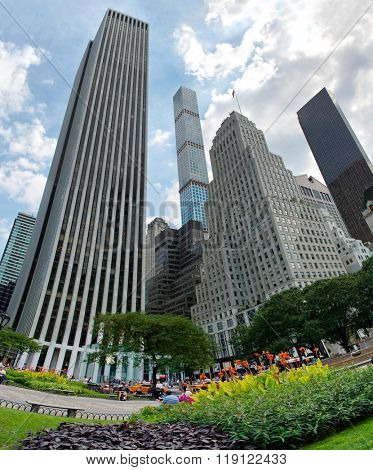 Low Angle Fish Eye View of Skyscrapers on Fifth Avenue from City Park with Manicured Gardens in Midtown Manhattan, New York City, New York, USA