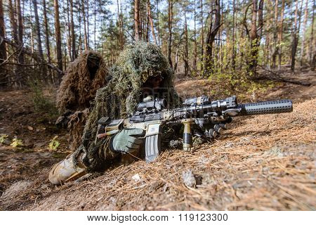 Snipers In Camouflage Suits Hiding In Forest