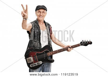 Senior punk bass player holding a guitar and making a peace hand gesture isolated on white background