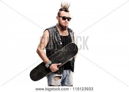 Punk rocker holding a skateboard and looking at the camera isolated on white background