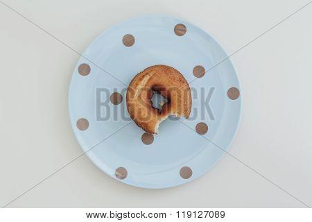 Donut bitten ( bitten on the dish )