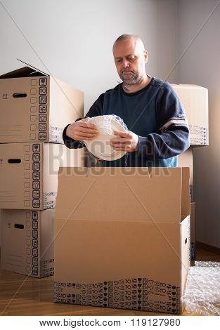 Man Packing Plates
