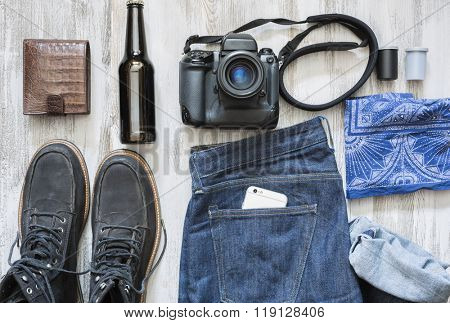 The objects of a film photographer on the white wooden background