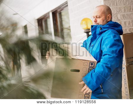 Man Carrying Moving Boxes