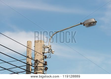 Street Light With Halogen Lamp Against Blue Sky